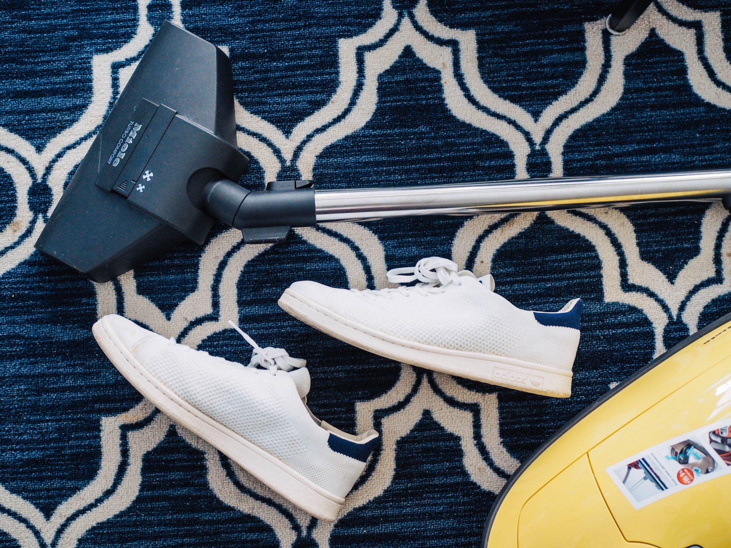 Vacuum cleaning home carpet